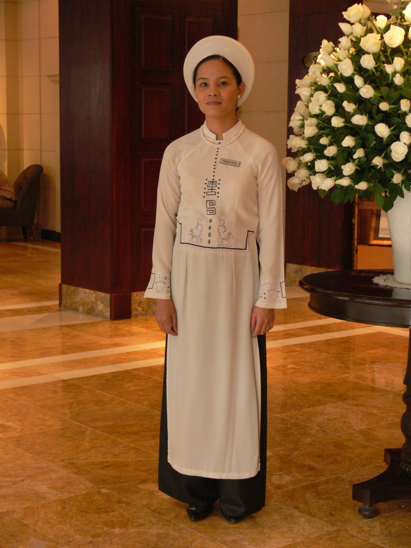 Ao Dai uniform - this Vietnamese lady looks stunning in her traditional uniform for the Metropole Hotel, Hanoi.