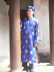 The men's version of the Ao Dai is worn at Tet and other important occasions, made from thicker silk brocade. This man wears it as part of his formal wedding photos. Taken at the Van Mieu - the Temple of Literature, Hanoi.