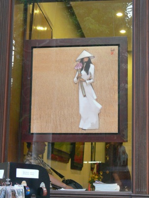 This painting shows a Vietnamese school girl wearing a traditional white Ao Dai