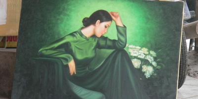 This painting depicts a Vietnamese woman wearing a traditional Ao Dai - beautiful Vietnamese woman has inspired many an artist.