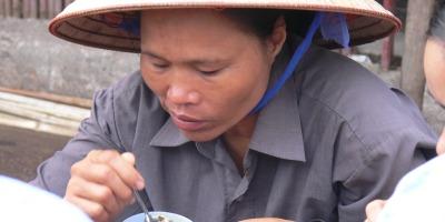 A great hearty breakfast item is a balut egg, cheap, served hot and as it's full of protein. This Vietnamese worker at Long Bien Market (Chợ Long Biên, Phúc Xá, Hoàn Kiếm, Hà Nội, Vietnam).