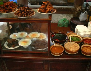 Cooked Sparrows and Quails, At Quan An Ngon restaurant is good as you can try lots of different delicacies. Displayed with condiments.