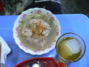 A popular dish in Hanoi, pigs brain in a broth with bean sprouts, washed down with iced tea.
