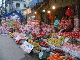 Pop up store for Tet supplies, fruit, gift basket and alcohol - just chose the items and they will wrap it up beautifully or chose from a ready made basket, Hanoi, Vietnam.