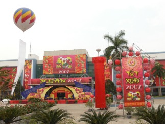 2007 - Exhibition Center looking festive to celebrate Tet. Buildings get dressed up like in the West we do for Christmas or other religious events., Hanoi, Vietnam.