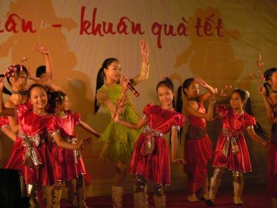 Young Vietnamese children perform in 2008, to celebrate Tet, Hanoi, Vietnam.