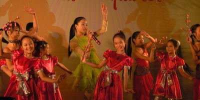 Young Vietnamese children perform in 2008, to celebrate Tet, Hanoi, Vietnam.