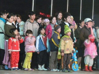 2008 photo - everyone of all ages is enthralled with this Tet performance.