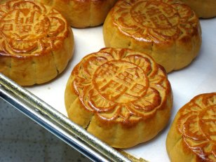 "Moon cakes - thanks to photographer - Behave + our friends at Wikipedia - ""Photo: Moon Cakes, 30 September 2006, photographer:misbehave This file is licensed under the Creative Commons Attribution-Share Alike 2.0, http://www.flickr.com/people/47489771@N00"""