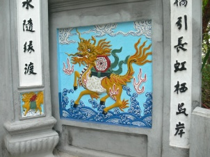 Taoist - This dragon-horse is watching and protecting Ngoc Son Temple. On his back he holds an I Ching symbols and the yin and yan which send evil spirits packing.