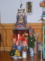 1. Land spirit-house on bottom 2. with offering 3. and Chinese God of Fortune figurine on top welcoming money.