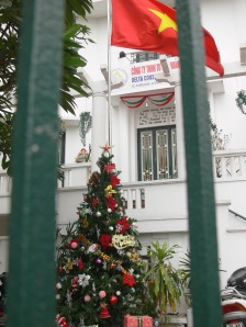 Vietnamese company has Christmas tree at the base of their flag pole, Hanoi, Vietnam