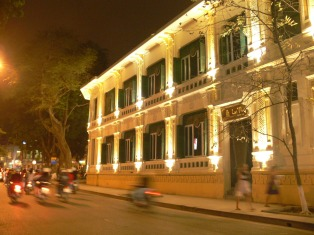 Hanoi By night - building corner Hang Trong and Le Thai Tho Streets.