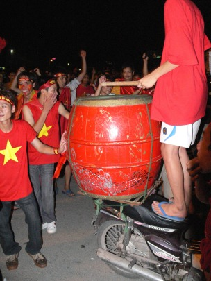 Even though Vietnam lost, young people were in high spirits enjoying an after match dance to the beat of a drum outside of the Stadium.