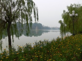 Hoan Kiem Lake - Every season is just beautiful ! Turtle Tower in the middle and spring flowers carefully planted around the lake.