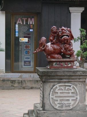 Temple of Literature- Văn Miếu - a lion protects from evil and double happiness symbol all in front of an ATM.
