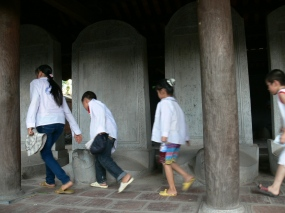 Students come to Temple of Literature- Văn Miếu touching each stone stelaes with the hope they will do well in school exams.