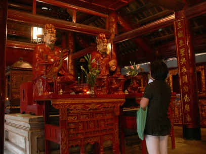 Inside the Sanctuary of the Great Success - lady praying. Van Mieu - Temple of Literature, Văn Miếu, entrance off Quốc Tử Giám Street, Hanoi
