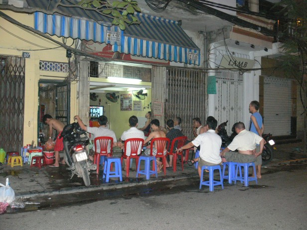 2010 Rugby Cup fever ! Groups get together to watch the matches, this group of Vietnamese men are lined up outside a restaurant waiting for the match to start.