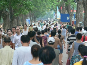 Traffic Update . . . congestion around Hoan Kiem Lake 6am every day. Hundreds of people take to the streets for a walk in Hanoi, Vietnam.