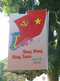 2010 poster: This is a beautifully designed sign with Vietnamese flag and Communist logo.