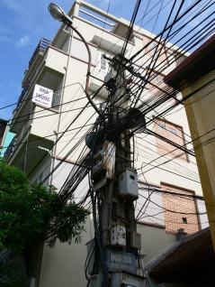 Wires, Light and Loud Speakers. - before you decide on renting a house with a year contract, make sure one of these poles aren't up near your bedroom window, otherwise there will be no sleep-ins !! Hanoi, Vietnam.