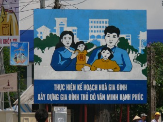 Carry out the Strategy of Family (2 children families), 2010 poster Hanoi, Vietnam.