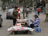 Newspaper shop - another drive in ! Conveniently situated on the edge of the footpath, right beside the road, so you can drive by, and the seller will jump up, get what paper you want and deliver it to your car - now that's service, Hanoi, Vietnam.