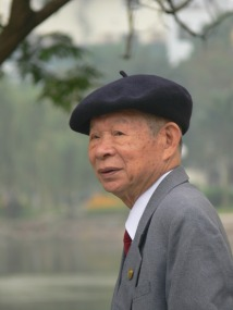 Well dressed elegant Vietnamese man wears a beret.