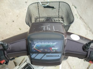 Christina's HonGda - never noticed the miss spelling, parking number on front, loved that bike in Hanoi, Vietnam.