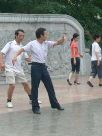 Ballroom dancing teacher his and students - Ly Thai To Park.