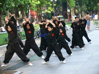 Early morning children's martial arts training at park on the corner of Quan Thanh, Hang Cot and Phan Dinh Phung, Hanoi.