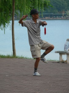 Tai Chi - Sword - I am looking straight down his sword. Occasionally practiced on the side of Truc Bach Lake, Hanoi on Tran Vu Street.