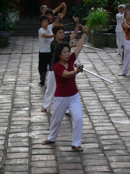 Vietnamese women practice a Sword Dance in the courtyard of Quan Thanh Temple, Truc Bach, Hanoi, Vietnam.