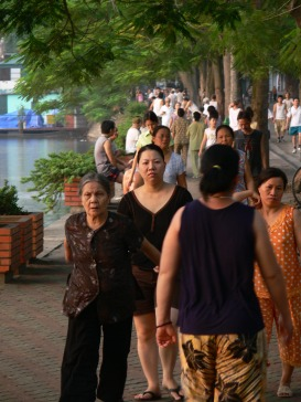 Walkers around Truc Bach Lake, Hanoi at 6.13am.