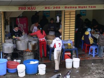 2010 photo - Pho Noodle shop uses charcoal rounds extensively, Hanoi, Vietnam.