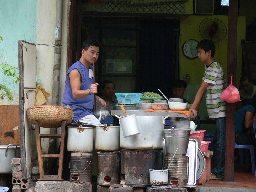 2010 photo - Noodle shop uses charcoal rounds for cooking fuel, Hanoi, Vietnam.