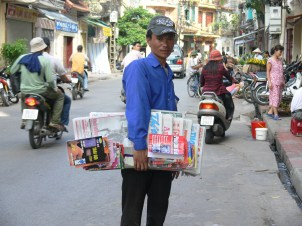 This Vietnamese street vendor is into diversification: when I met hi in 2010 he wanted to sell me a newspaper but I cannot read it . .. . . he smiled and pulled out a map !! SOLD !!