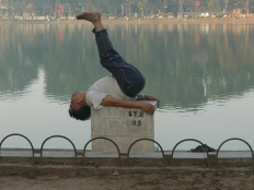 Vietnamese man does early morning exercise routine. - lakeside Hoan Kiem Lake, Hanoi !!