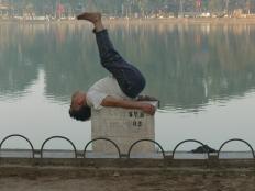 Vietnamese man does early morning exercise routine. - lakeside Hoan Kiem Lake, Hanoi !!