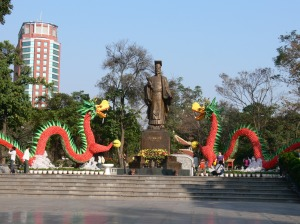 Ly Thai To Park (Vườn hoa Lý Thái Tổ -Two dragons as New Year (Tet) decoration facing the statue of Ly Thai To. Hanoi, Vietnam