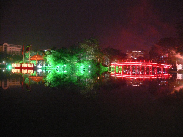 Night view looking at Ngoc Temple on left and The Hoc Bridge. on right Hanoi.