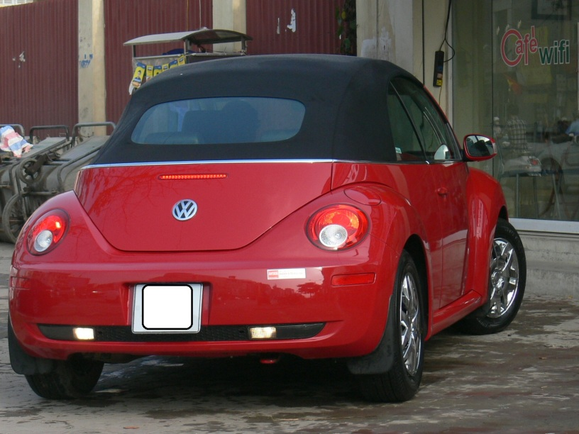 2010 photo - VW soft top: perfect for those balmy Autumn Hanoi days, Hanoi, Vietnam.