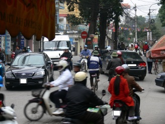 Driving in Hanoi - many skills needed - eyes in the back of your head and heaps of defensive driving skills and short term memory loss - forget what you know at home, follow the traffic flow in Hanoi, Vietnam.