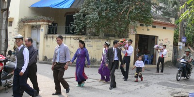 Wedding Proposal - man's family lead the way to the prospective brides house.