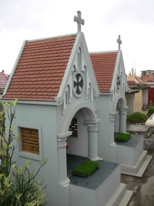 Elaborate memorial houses in a Hanoi cemetery.