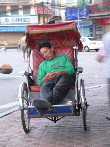 Cyclo Driver in Hanoi, caught sleeping on the job !!!