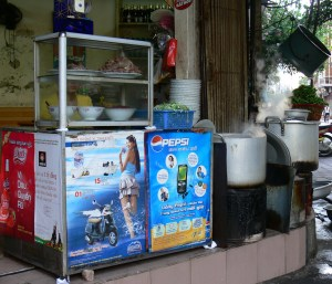 Hanoi -typical shop, boiling pots on the street edge, everyone knows they are hot of course !