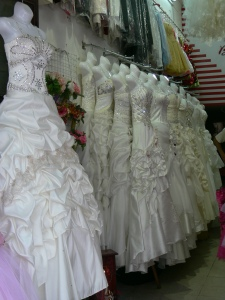 Wedding dresses lined up in Wedding Dress shop