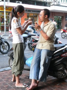 A couple eat icecream at Trang Tien Icecream